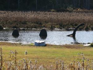 Loch Ness Monster in pond along Rt. 390.