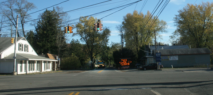 A school bus passes electric no hunting sign in downtown Canadensis.